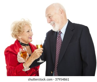 Happy senior couple making a toast with champagne.  Isolated on white.