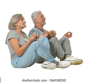 happy Senior couple meditating