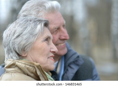 happy senior couple on a walk in nature in autumn