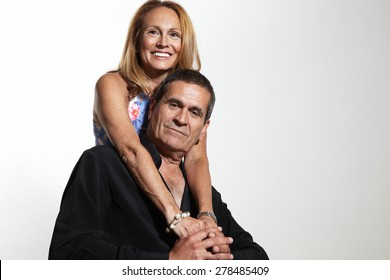 happy senior couple on a white background