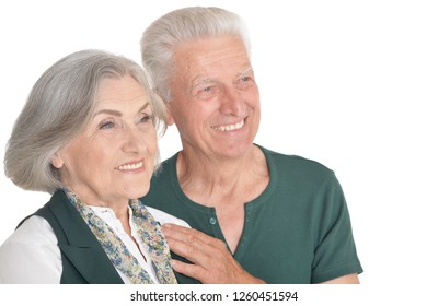 Happy senior couple posing isolated on white background