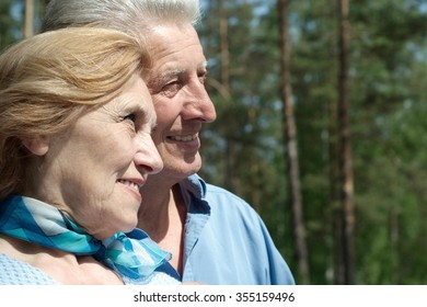 Happy senior couple relax in autumn park