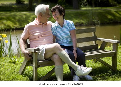 Happy senior couple sitting on a bench