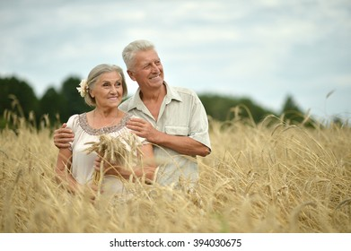 happy senior couple in summer