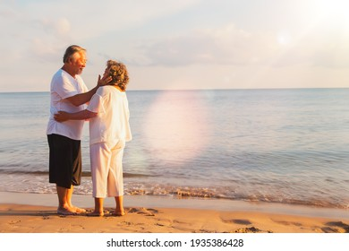 Happy senior couple summer beach : bond of a retired Asian couple, a lasting relationship together forever : Romance of an elderly couple on a peaceful beach concept