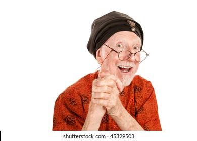 Happy senior guru with his hands clasped