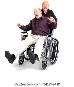 Happy Senior Male & Female Couple with man in wheelchair in casual outfit - Isolated