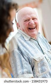 Happy senior man sitting indoor