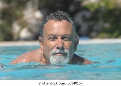 happy senior man in the swimming pool
