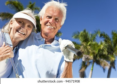 Happy senior man and woman couple together playing golf