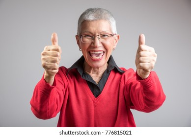 Happy senior old lady giving thumbs up, supporting your decision fully