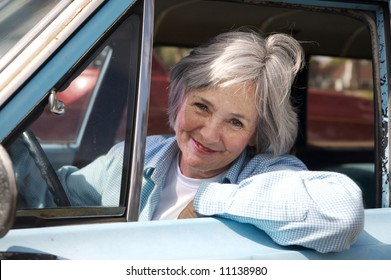 Happy senior out driving the old car