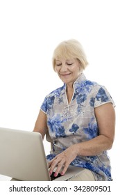 Happy senior woman with computer isolated on white