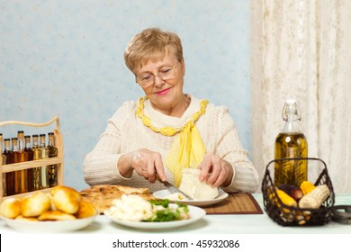 Happy senior woman cooking in the kitchen
