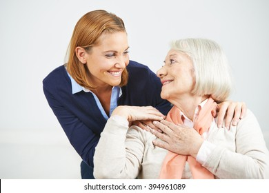 Happy senior woman and daughter smiling at each other