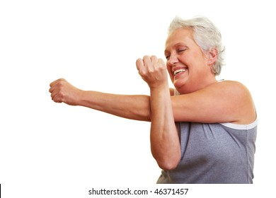A happy senior woman doing fitness exercises