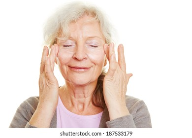 Happy senior woman doing skin care for her face