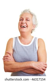 Happy senior woman with her arms crossed