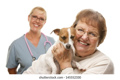 Happy Senior Woman with Her Dog and Veterinarian Behind Isolated on a White Background.