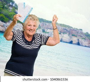 Happy Senior Woman Holding Boarding Pass, Outdoors