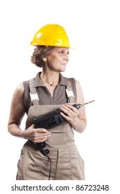 Happy senior woman holding a drill tool (isolated on white)