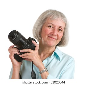 Happy senior woman holding her camera. Photo has potential as a retirement lifestyle image.