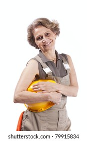 Happy senior woman holding a safety hat (isolated on white)
