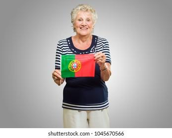 Happy Senior Woman Holding Spain Flag On Grey Background