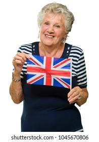 Happy Senior Woman Holding United Kingdom Flag On White Background