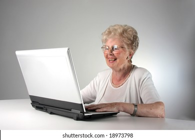 happy senior woman with laptop