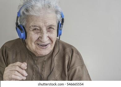 happy senior woman listening music with headphones
