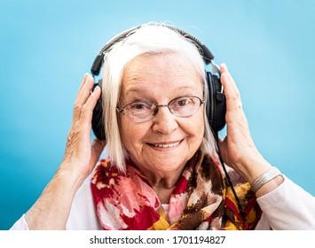 Happy Senior Woman Loves Music and Fun