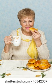 Happy senior woman with pie and cup
