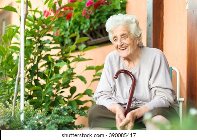 Happy senior woman sitting outside