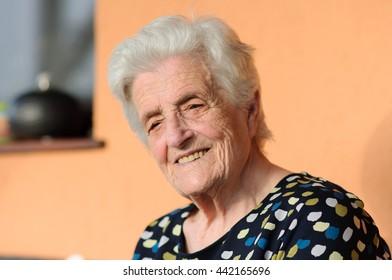 Happy senior woman sitting outside