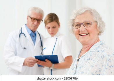 Happy senior woman smiling at camera after her medical exam at hospital