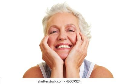 Happy senior woman smiling into the camera