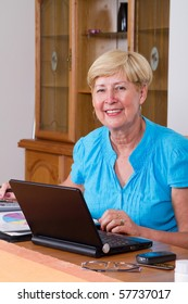 happy senior woman working on home finance