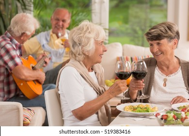 Happy senior women drinking red wine  for husbands!