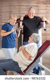 Happy seniors talking in a break in a fitness center