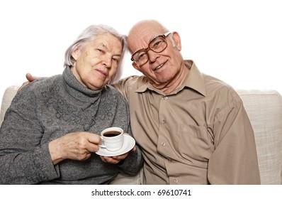 Happy senour couple drinking coffee