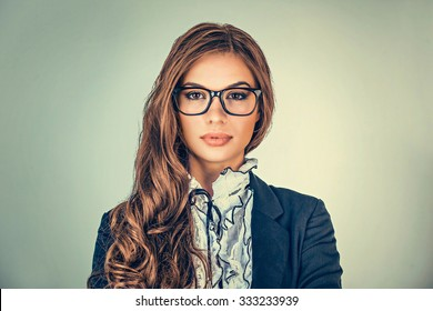 Happy serious young beautiful happy business woman looking at you isolated grey background wall. Closeup confident lawyer teacher office manager. Positive human emotions facial expressions, attitude