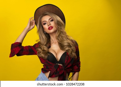 Happy sexy cowgirl on yellow background