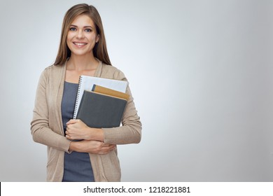 Happy shcool teacher holding books. Isolated professional portrait.