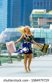 Happy shopper with shopping bags at Marina bay in SIngapore