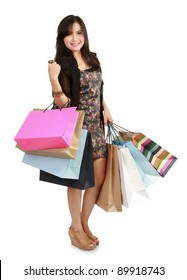 happy shopping girl holding bags in white background