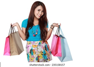 happy shopping girl holding shoping bags in hands. over white background