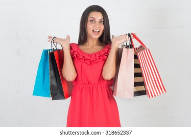 Happy shopping, sale. Beautiful woman with a lot of shopping bags