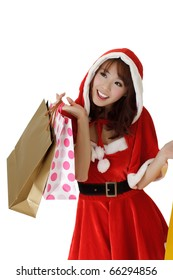 Happy shopping woman with bags in Santa Claus clothes.