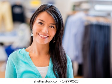 Happy shopping woman at a clothing store